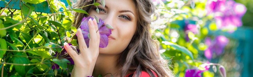 Portrait of the beautiful girl in violet flowers