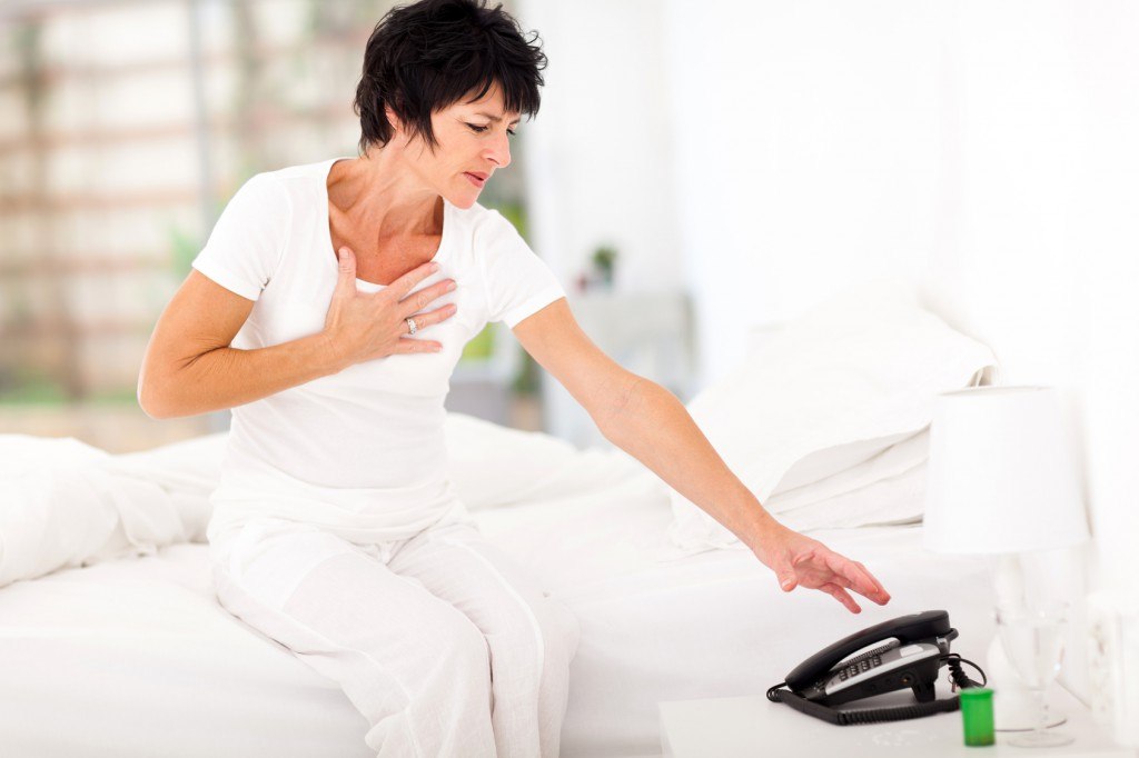 middle aged woman having heart attack